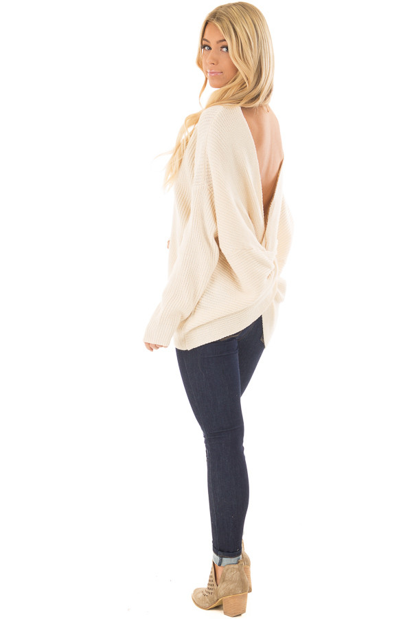 Ivory Long Sleeve Oversized Sweater with Back Twist Detail over the shoulder full body