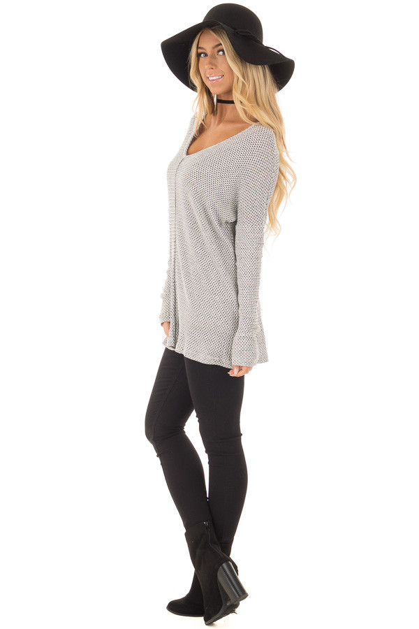 Ivory and Black V Neckline Top with Stitching in Center side full body