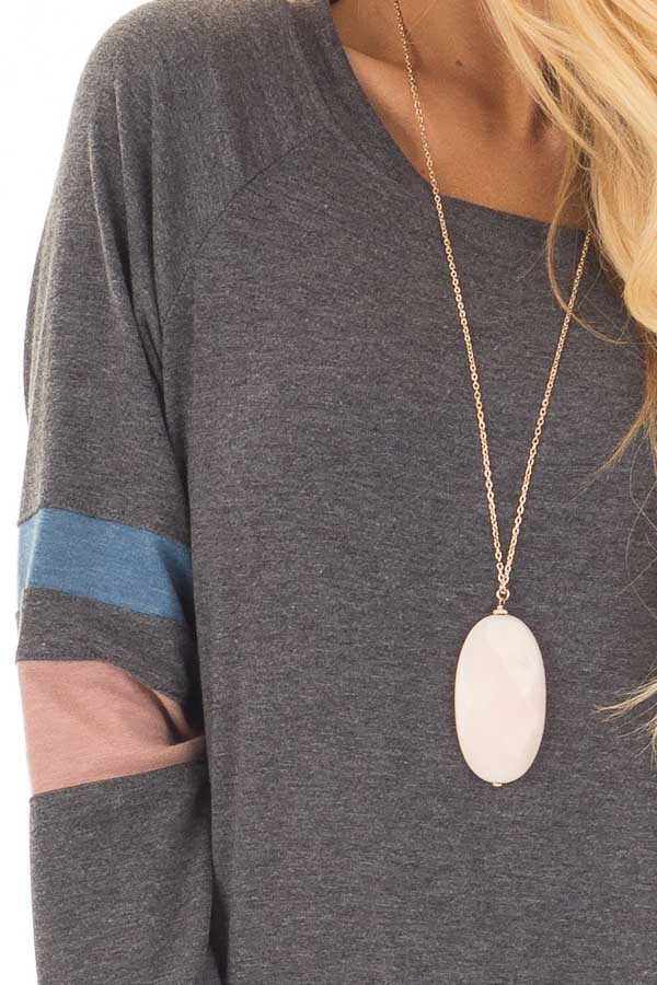 Charcoal Long Sleeve Top with Blue and Dusty Pink Stripes front detail