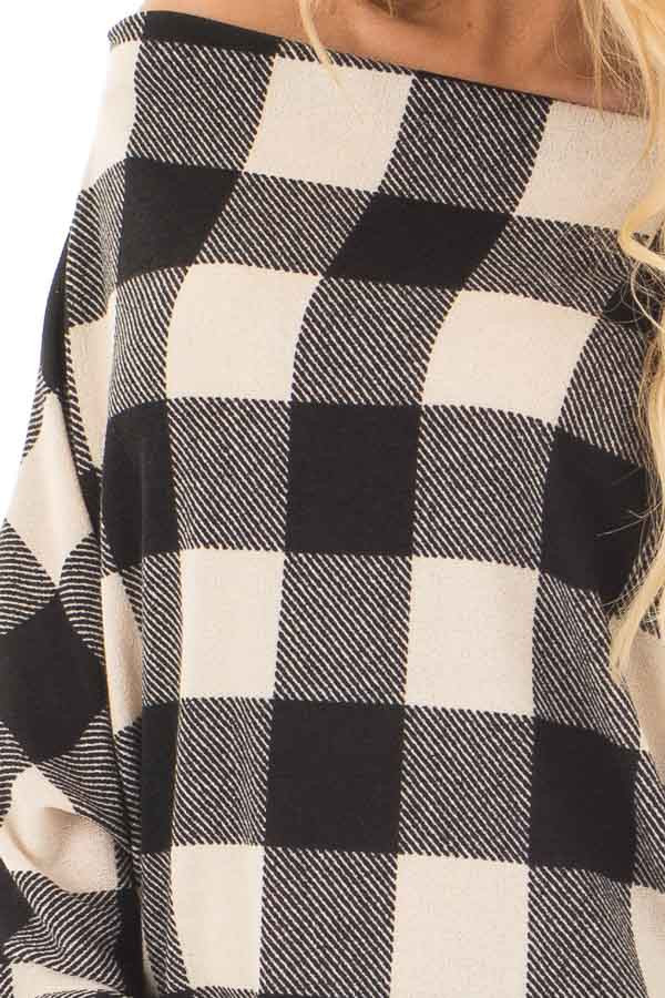 Black and Ivory Plaid Boat Neck Dolman Sleeve Top front detail