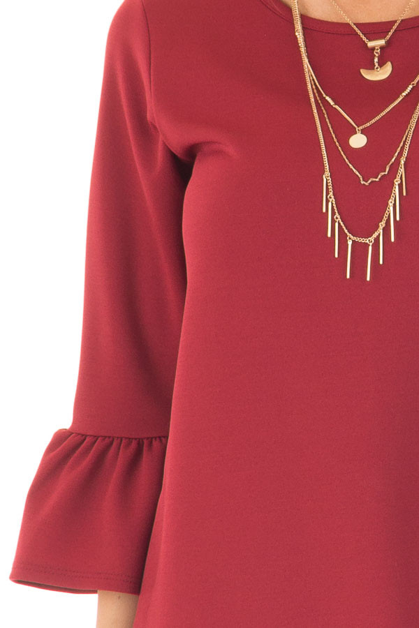 Deep Red 3/4 Sleeve Dress with Bell Flare Sleeve Detail front detail