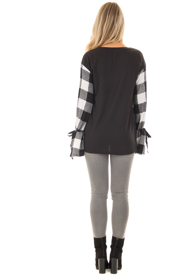 Black Sweater with Plaid Sleeves and Tie Cuff Detail back full body