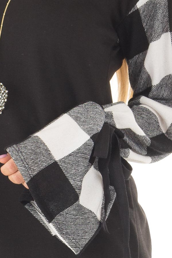Black Sweater with Plaid Sleeves and Tie Cuff Detail front detail