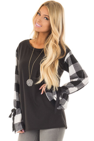Black Sweater with Plaid Sleeves and Tie Cuff Detail front closeup