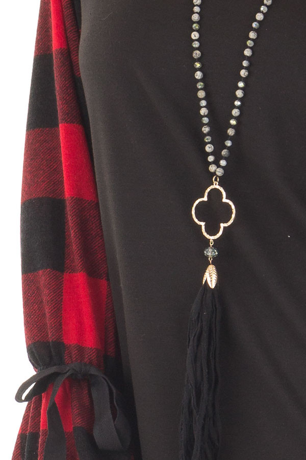 Black Sweater with Red Plaid Sleeves and Tie Cuff Detail front detail