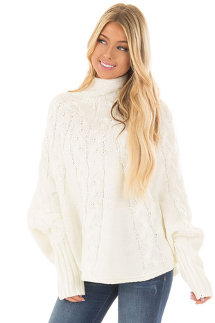 Ivory Cable Knit High Neck Poncho Style Top with Cuffs front closeup