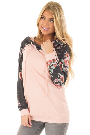 Peach Hoodie with Floral Print Contrast and Eyelet Details front closeup