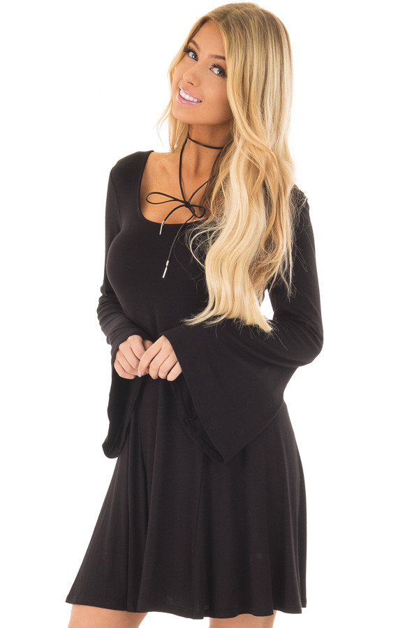 Black Swing Dress with Open Back and Bell Sleeves front closeup