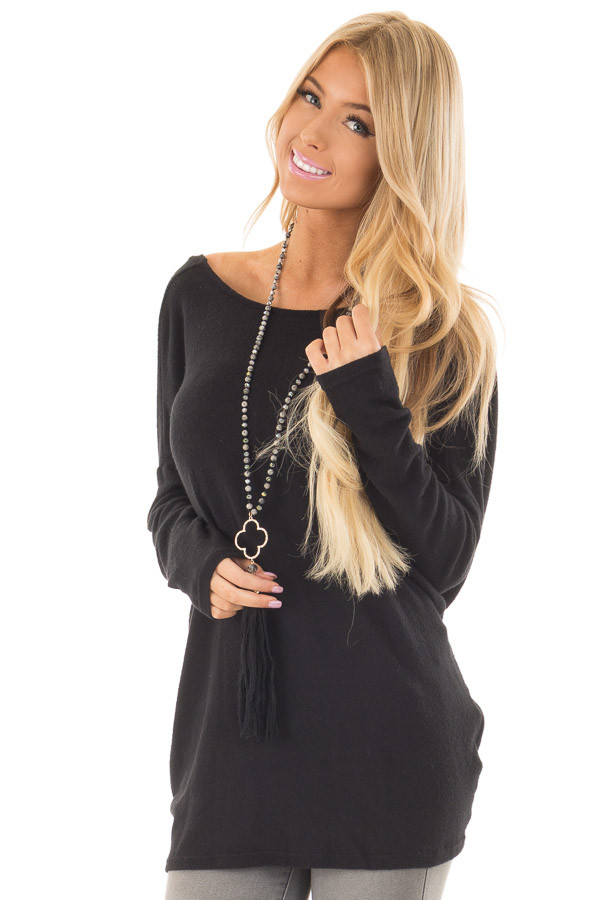 Black Long Sleeve Top with Open Back and Twist front closeup