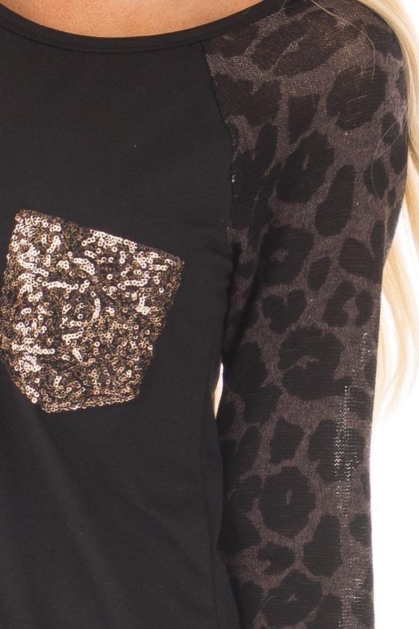 Black Top with Leopard Raglan Sleeves and Sequin Pocket front detail