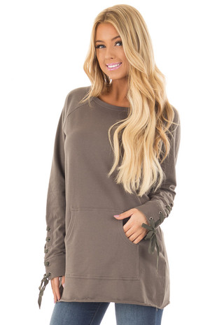 Olive Tunic with Lace Up Cuffs and Front Pocket front close up