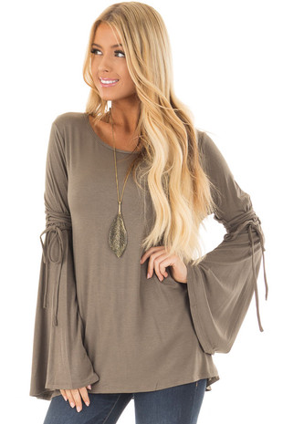 Olive Long Bell Sleeve Top with Lace Up Detail front closeup