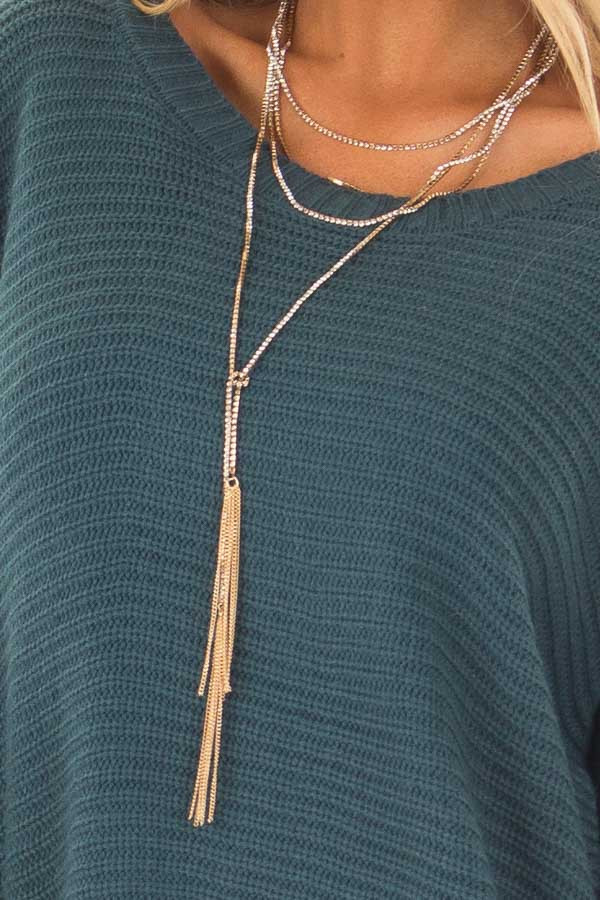 Gold Layered Crystal Necklace with Gold Tassels close up