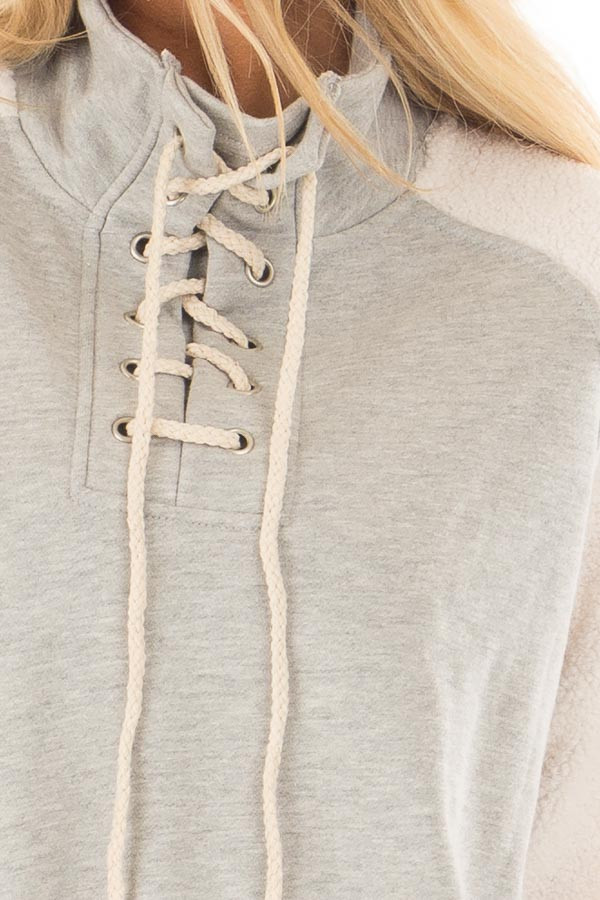 Heather Grey High Neck Lace Up Sweater with Sherpa Sleeves detail
