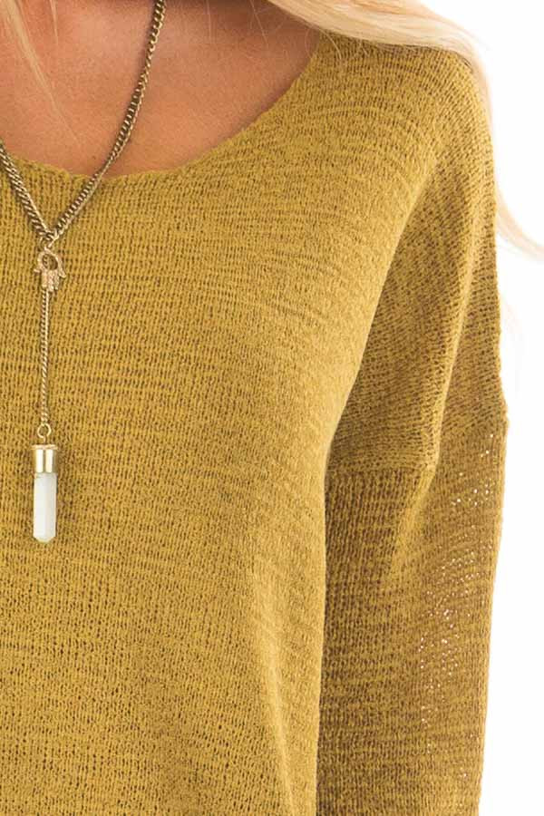 Golden Boat Neck Sweater with Side Slits detail