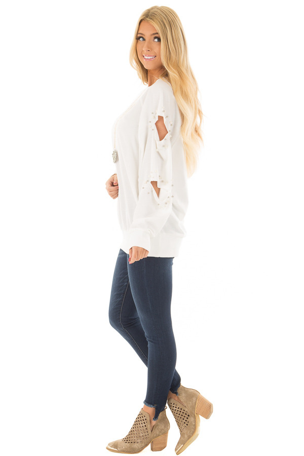 Ivory Oversized Top with Sliced and Beaded Detail side full body