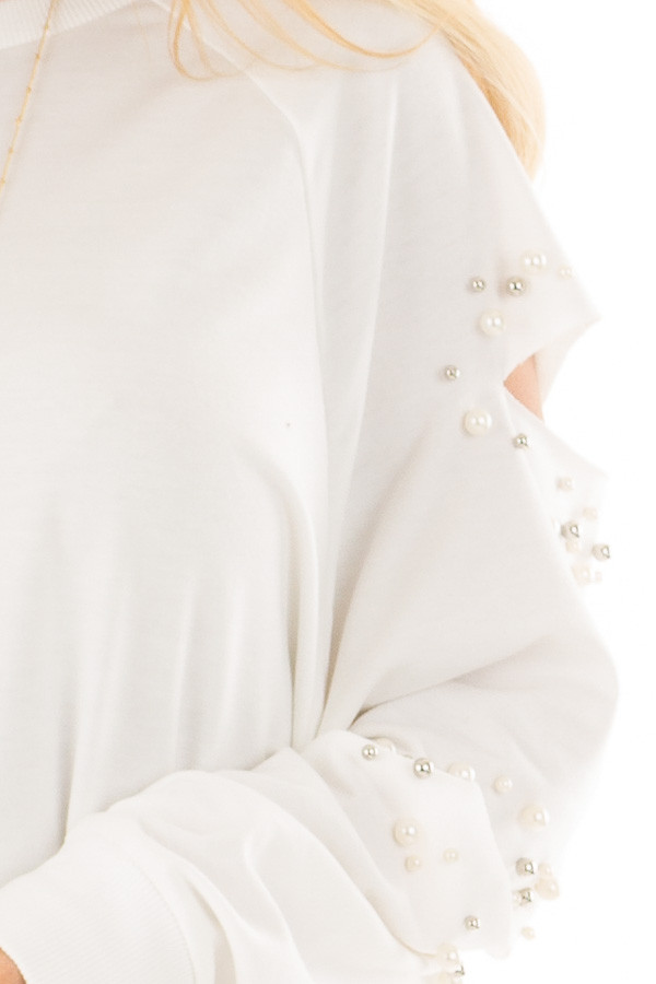 Ivory Oversized Top with Sliced and Beaded Detail detail