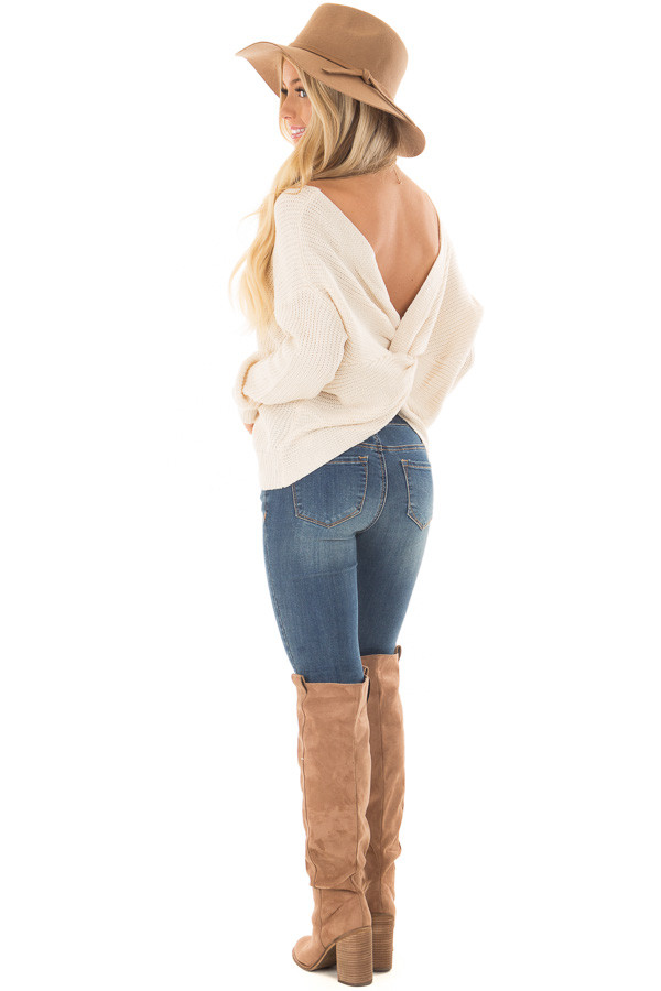 Ivory Knit Sweater with Twisted Open Back over the shoulder full body