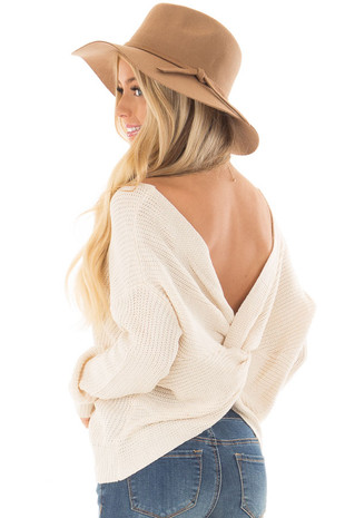 Ivory Knit Sweater with Twisted Open Back over the shoulder closeup