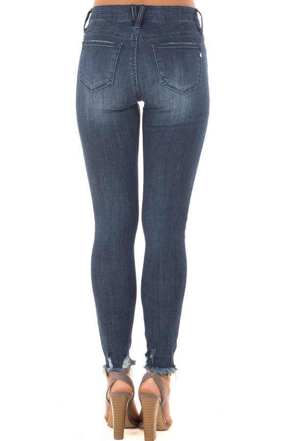 Dark Wash Stretchy Skinny Jeans with Lightly Distressed Hem back view