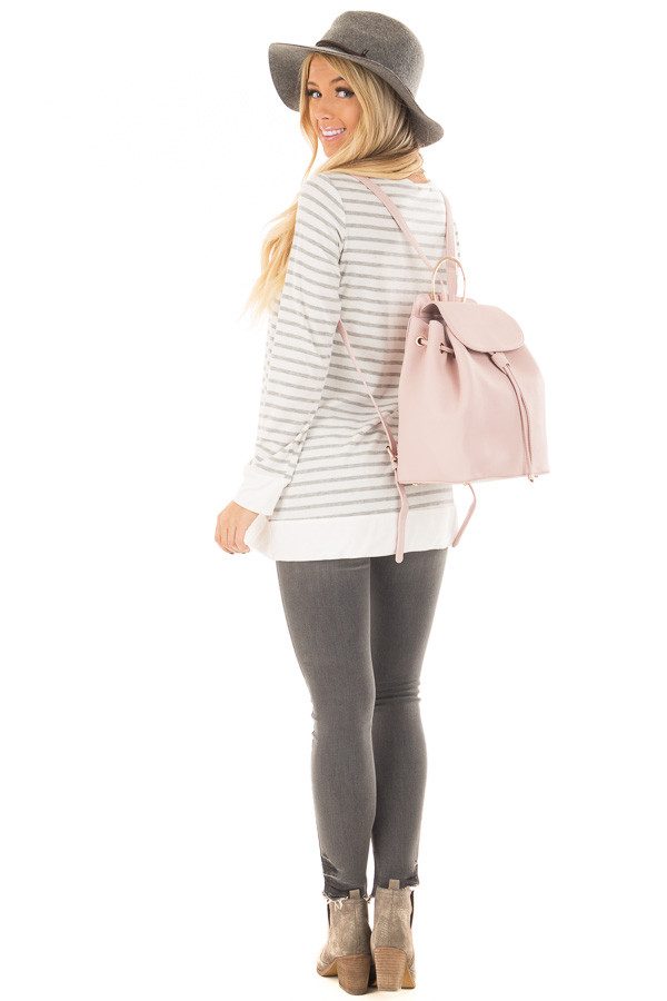 Blush Backpack with Gold Handle and Details over the shoulder full body