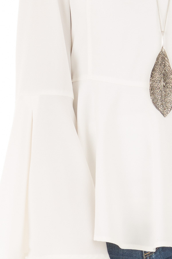 Off White Peplum Top with Bell Sleeves front detail