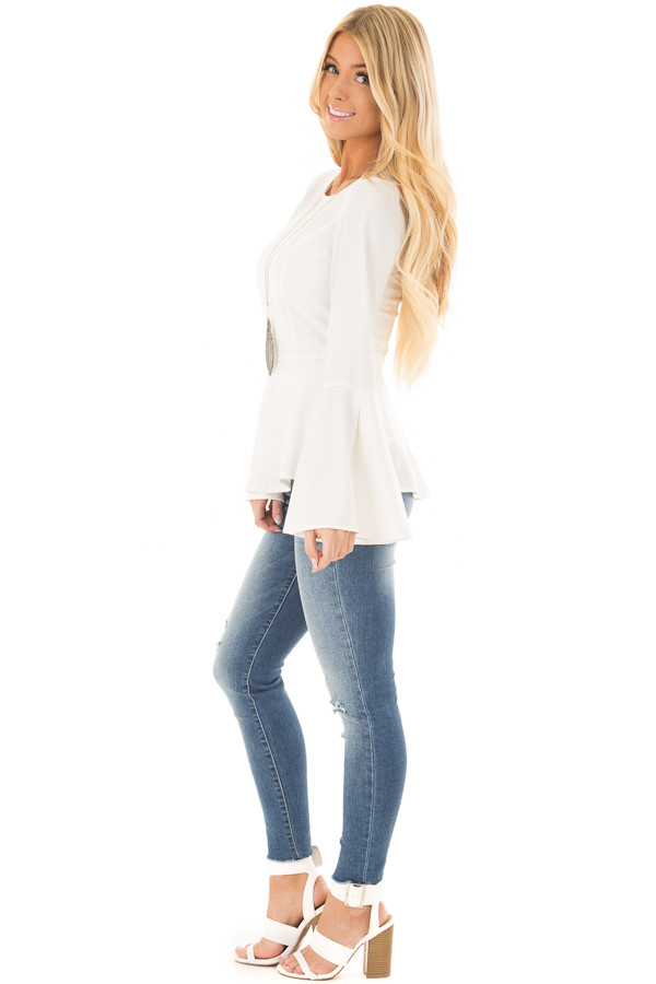 Off White Peplum Top with Bell Sleeves side full body