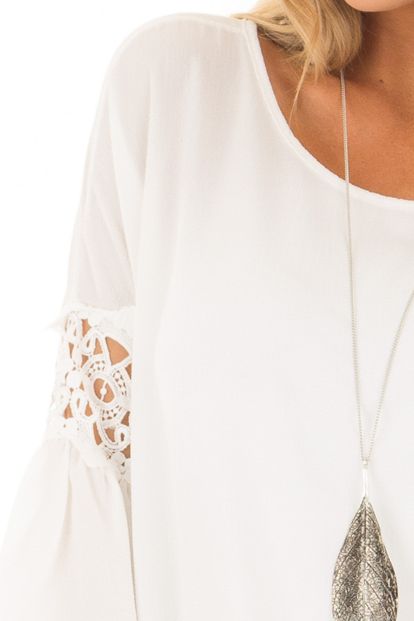 Off White Blouse with Sheer Lace Details on Sleeves detail
