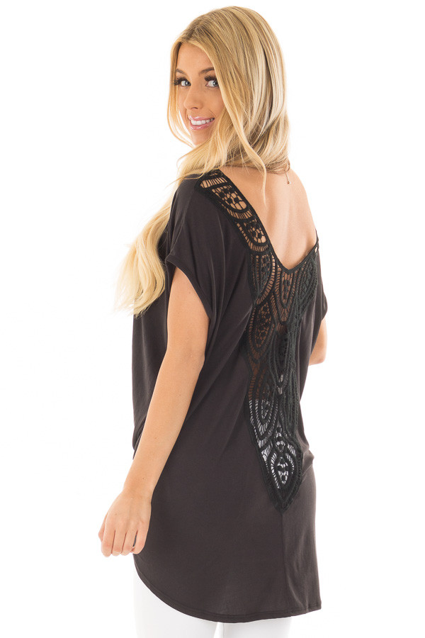 Black V Neck Top with Front Twist and Sheer Lace Detail over the shoulder closeup