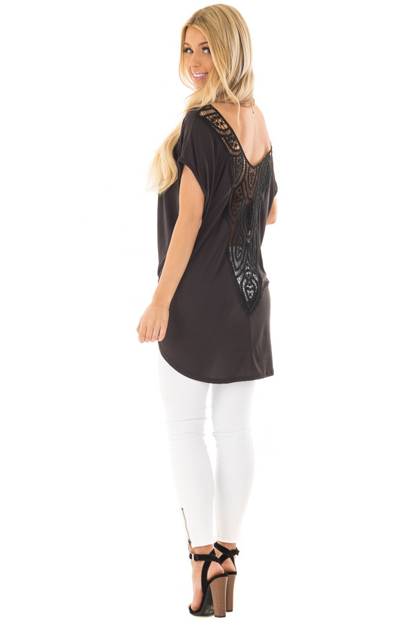 Black V Neck Top with Front Twist and Sheer Lace Detail over the shoulder full body
