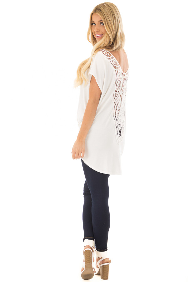 Ivory V Neck Top with Front Twist and Sheer Lace Detail over the shoulder full body