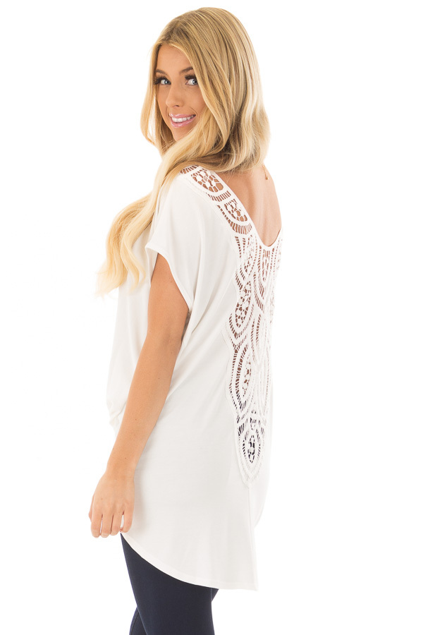 Ivory V Neck Top with Front Twist and Sheer Lace Detail over the shoulder closeup
