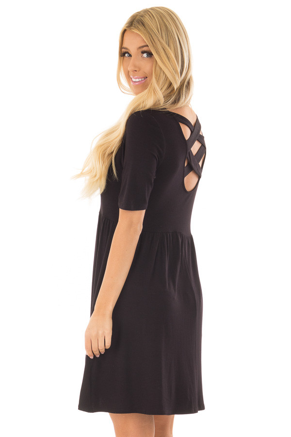 Black Dress with Criss Cross Strap Detail over the shoulder closeup