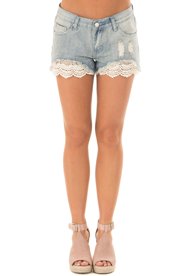Light Denim Distressed Shorts with Lace Peek a Boo front