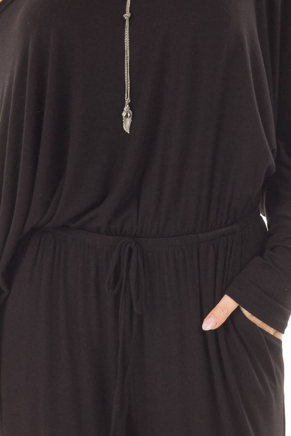 Black Off the Shoulder Jumpsuit with Waist Tie front detail