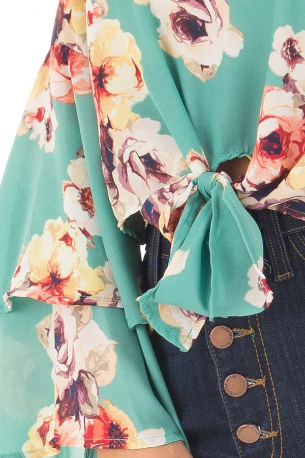 Teal Floral Print Crop Top with Bell Sleeves and Front Tie front detail