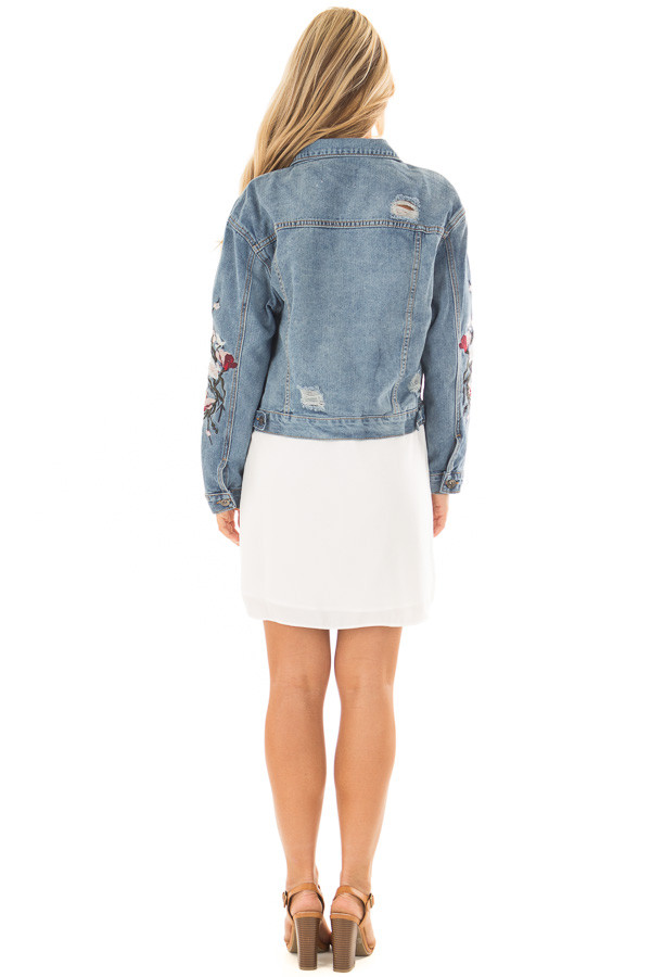 Medium Wash Distressed Denim Jacket With Embroidery Detail back full body