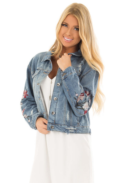 Medium Wash Distressed Denim Jacket With Embroidery Detail front close up