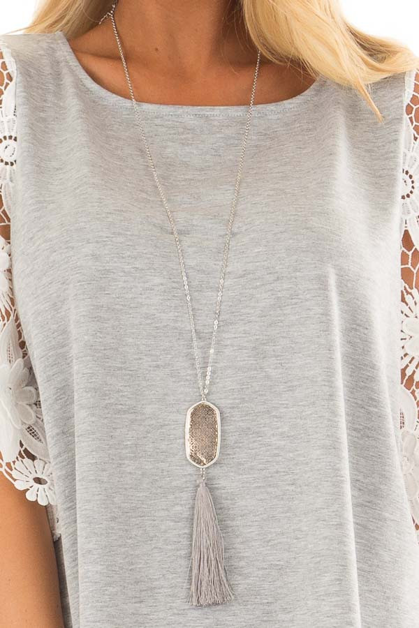 Cloud Grey Tassel Necklace with Intricate Pendant close up