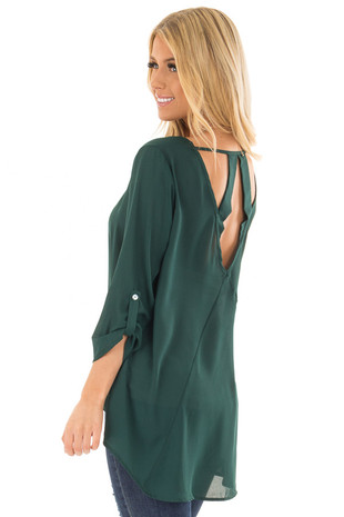 Hunter Green Top with Back Cutout and Button on the Sleeves side closeup
