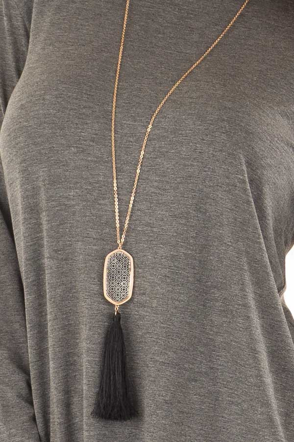 Black Tassel Necklace with Intricate Pendant detail