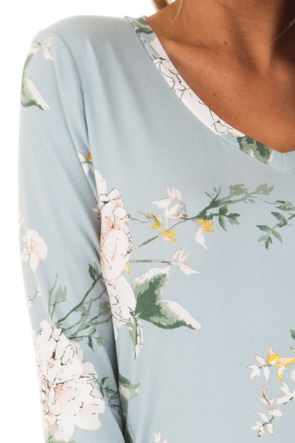 Aqua V Neck Top with Floral Print Detail front detail