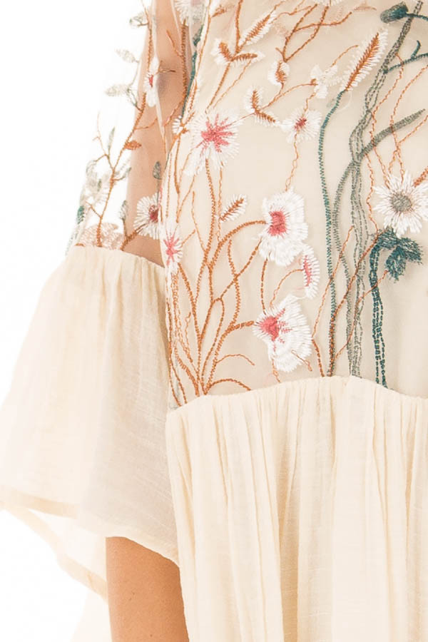 Cream Embroidered Flowy Bell Sleeve Dress front detail