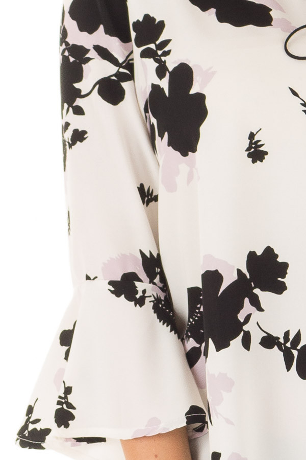 White Flower Print Blouse with 3/4 Bell Sleeves detail