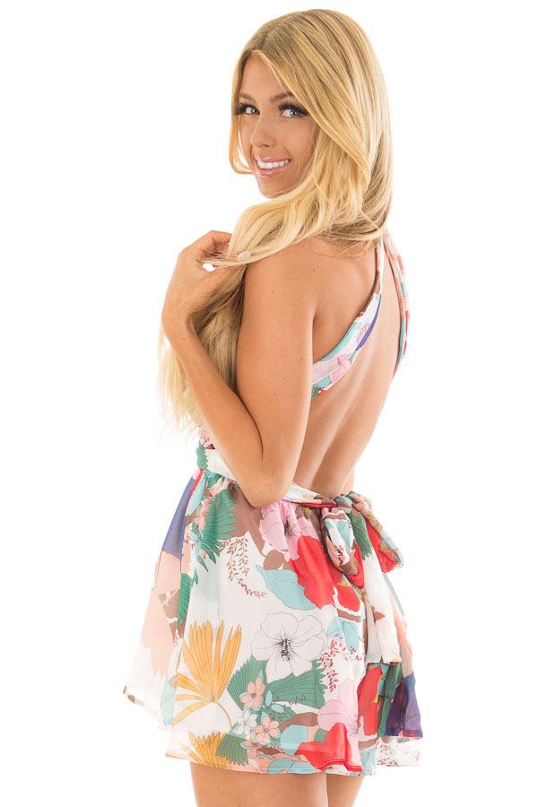 White Tropical Floral Print Romper with Plunging Neckline over the shoulder closeup