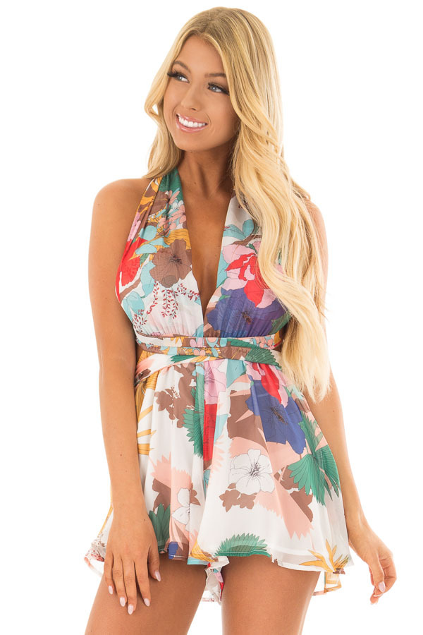 White Tropical Floral Print Romper with Plunging Neckline front closeup