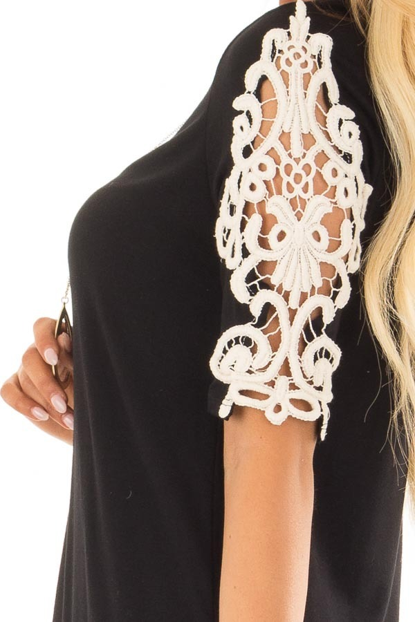 Black Top with Sheer Lace Sleeve Detail detail