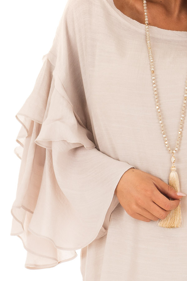 Cream Boatneck Top with Oversized Flowy Sleeves detail