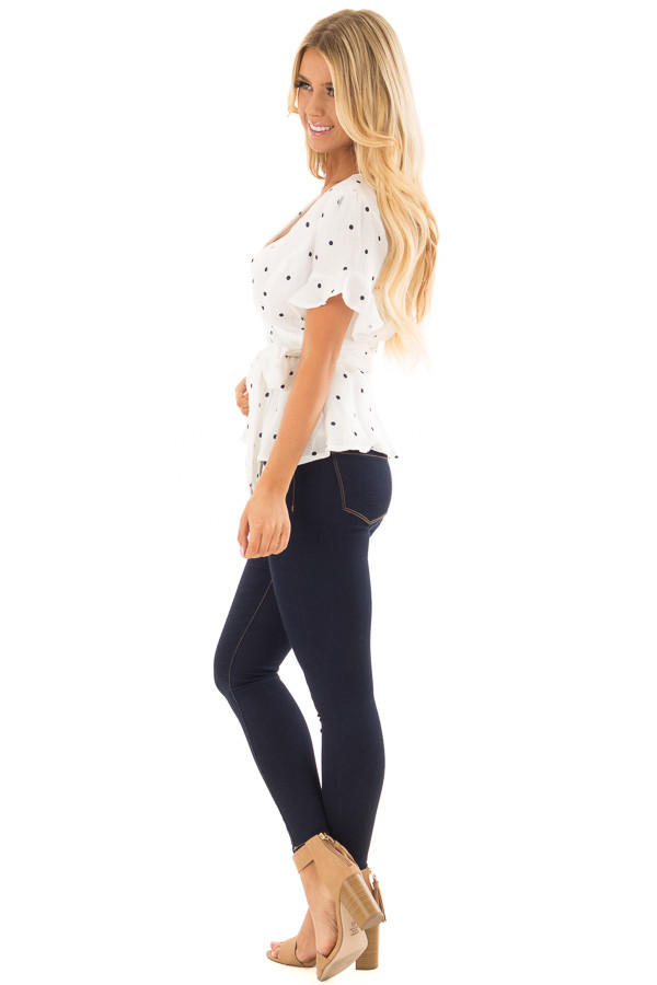 White Deep V Neck Top with Navy Polka Dots and Ruffle Detail side full body