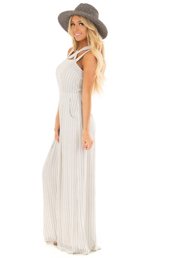 White and Black Stripe Jumpsuit with X Neckline side full body